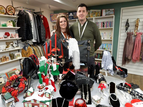 Jamie and Rachel Richards in their charity's new shop in Newport