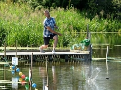 Hundreds at British stone skimming championships in Shropshire - with pictures