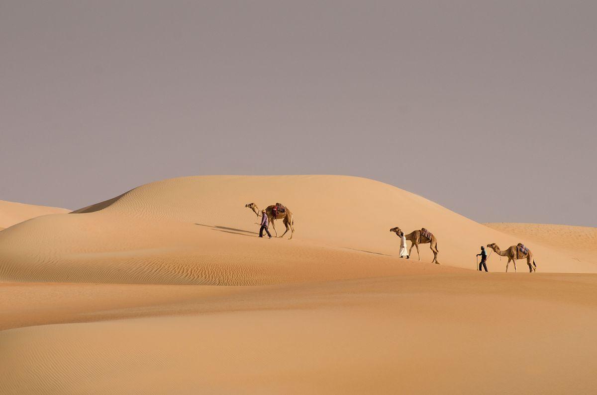 Mark Evans, front, passing through the sand dunes just inside Saudi Arabia