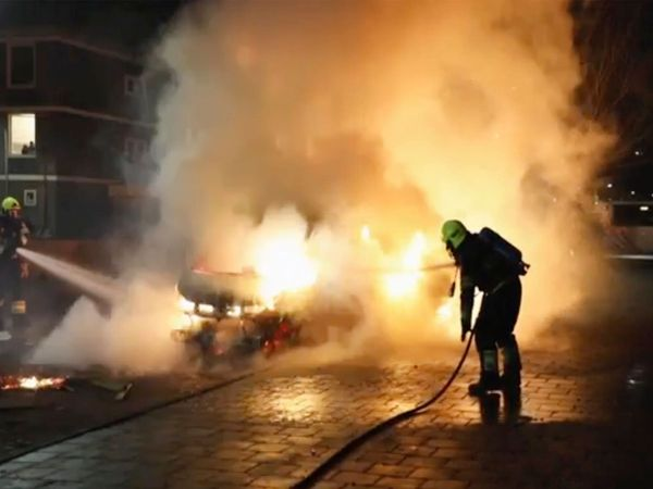 Virus Outbreak Netherlands Riots