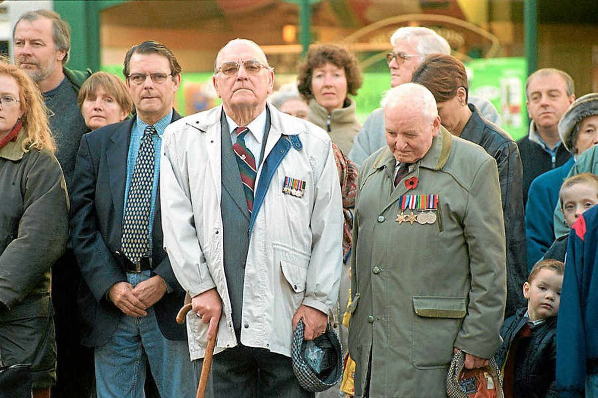 Harry Langford and Vincent Davies, front, both former members of the 4th Kings Shropshire Light Infantry, pay their respects to the fallen on Remembrance Day