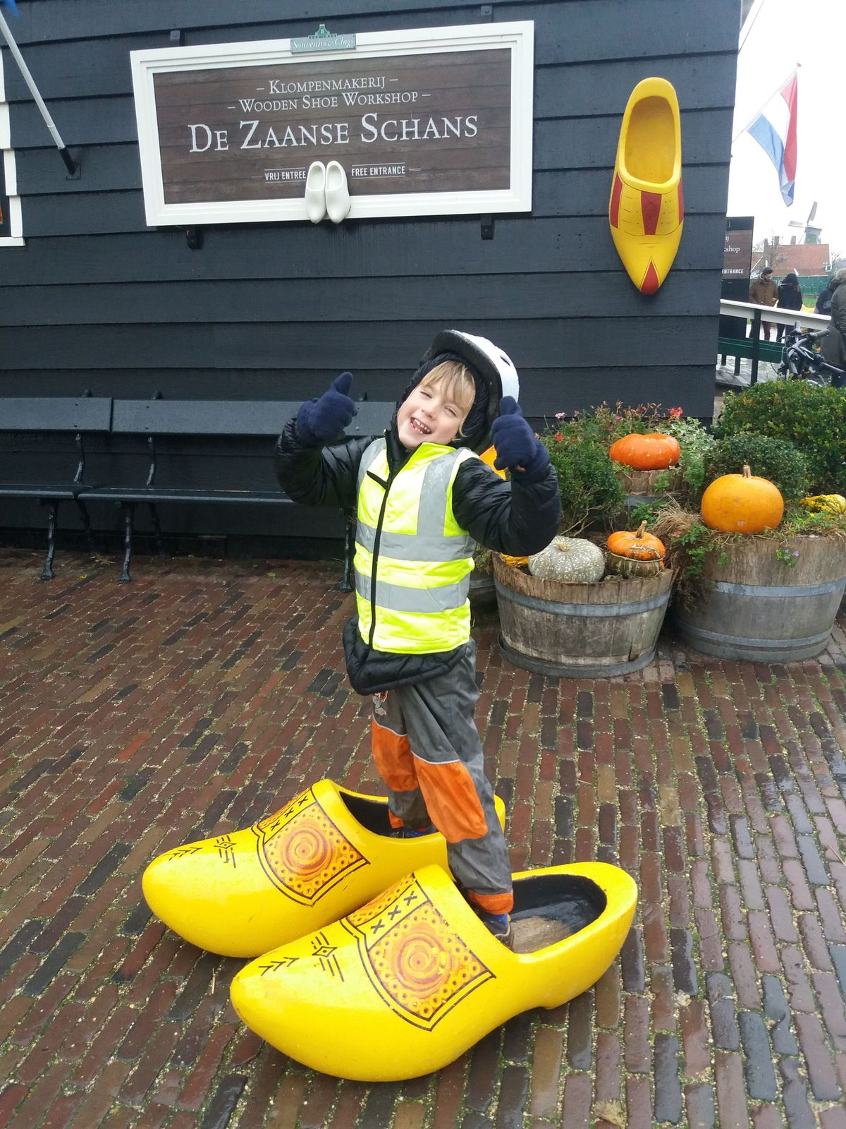 Harrison tries on a pair of clogs for size in Amsterdam