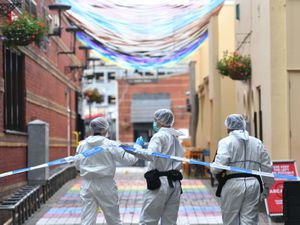 Police forensics officers at work in Hurst Street, in Birmingham after a number of people were stabbed in the city centre