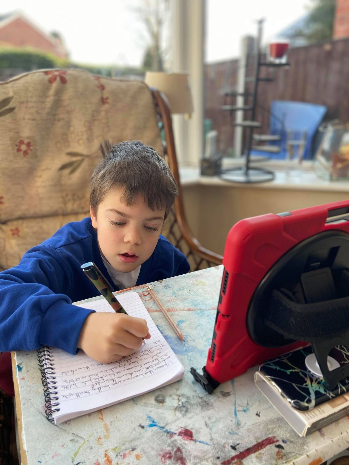 Margaret's own grandson, eight year old Talon, doing his remote learning
