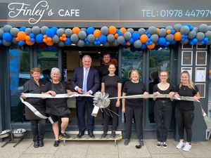 Photo of Gaynor Gee, Babs Wooding, Simon Baynes MP, Tom and Rebekah Price, Karen Johnstone (Rebekah's mother), Madison Griffiths and Courtney Greenwood outside Finley's Café in Llangollen