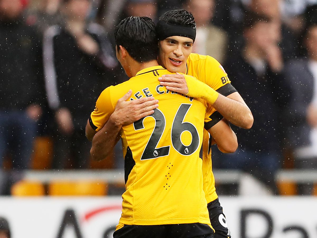 Hee-chan Hwang of Wolverhampton Wanderers celebrates scoring his team's first goal with Raul Jimenez. (Photo by Jack Thomas - WWFC/Wolves via Getty Images).