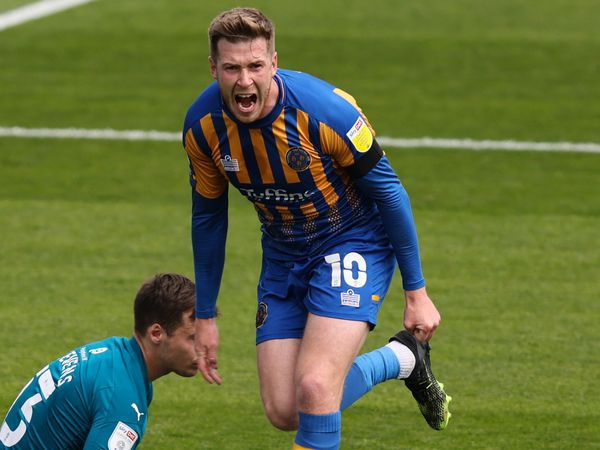 Josh Vela of Shrewsbury Town celebrates after scoring a goal to make it 2-1.