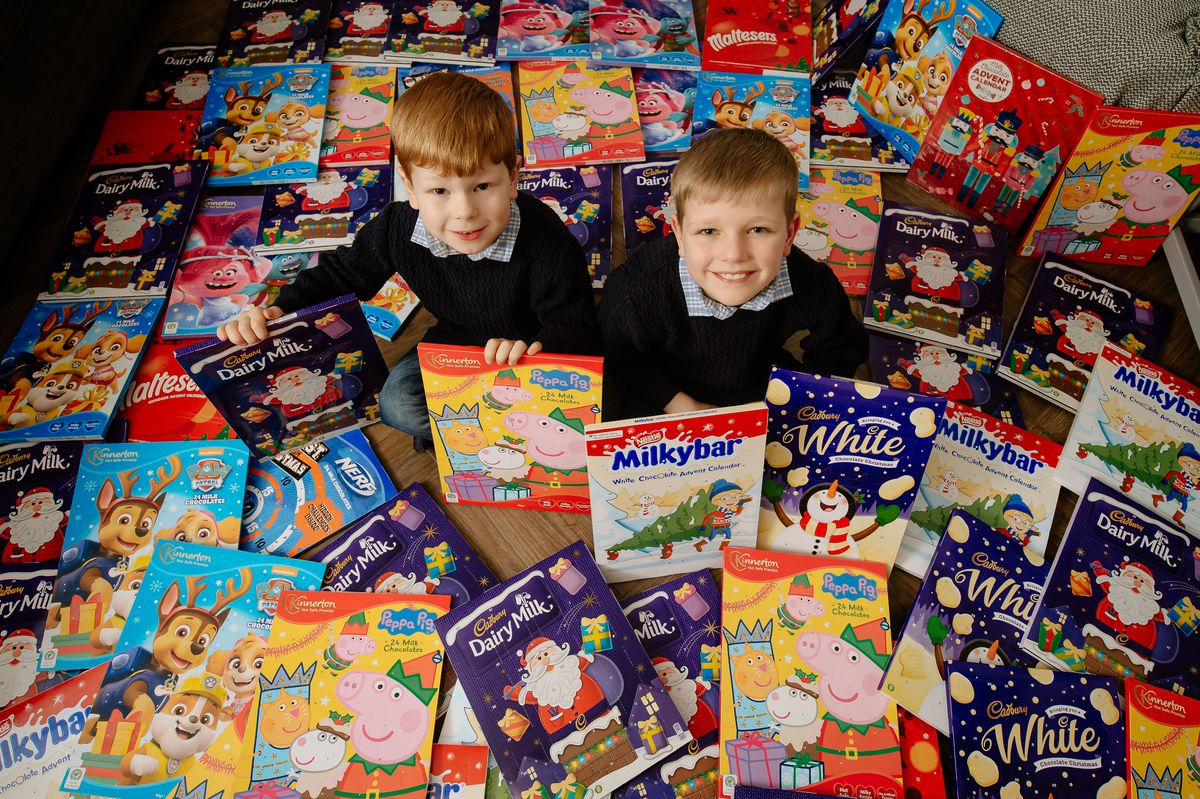 Youngsters Charlie (left) and Liam Randall, four and eight, have been collecting advent calendars for others with their mother Lorraine this year. The calendars, 108 in all, will go to the Market Drayton Foodbank and the Alice Charity of Newcastle-under-Lyme