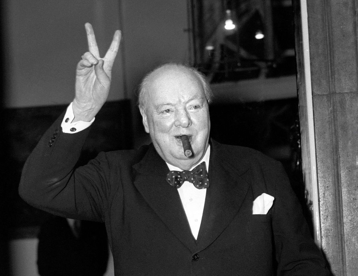 Sir Winston Churchill giving his famous V for Victory at the end of the Second World War