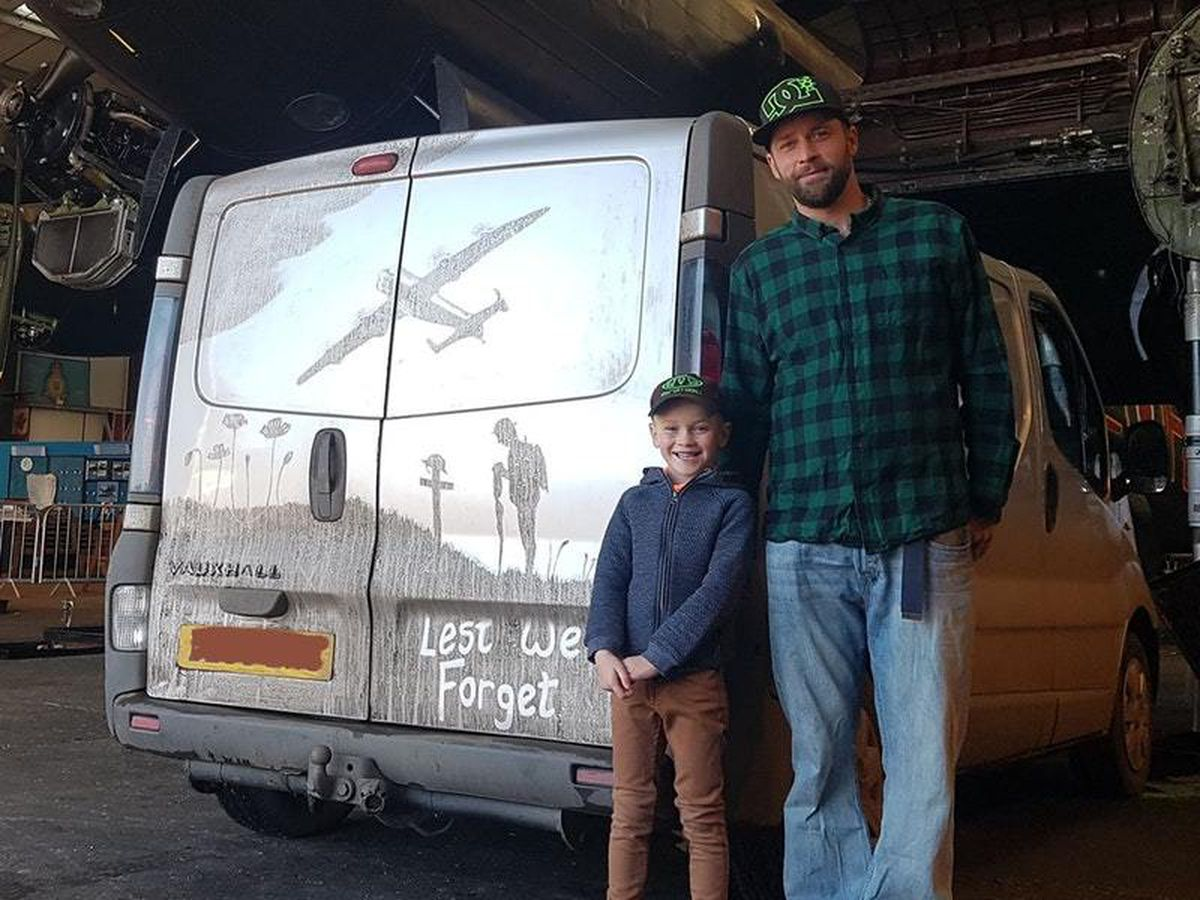 Shaun and his son Zak with the van and a Lancaster Bomber