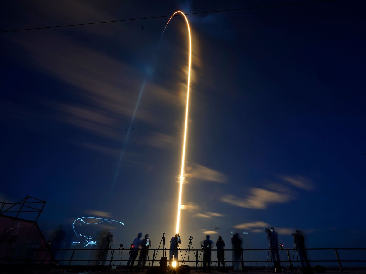 A SpaceX Falcon 9 rocket, with four private citizens onboard, lifts off in this time-exposure photo from Kennedy Space Centre's Launch Pad 39-A