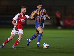 Callum Camps of Fleetwood Town and Oliver Norburn of Shrewsbury Town (AMA)