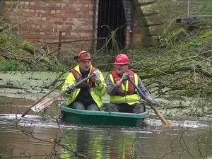 Alistair Price, and Waterway Recovery Group leader Ian Gaston, take to the water