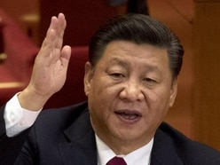 China's Communist Party inserts President Xi Jinping into constitution