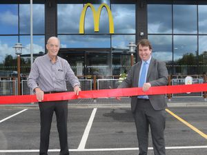 Cutting the ribbon at the official opening of the new McDonald's in Welshpool are right, Montgomeryshire MP Craig Williams and Franchisee Bob Beckett.Picture by Phil Blagg Photography.
