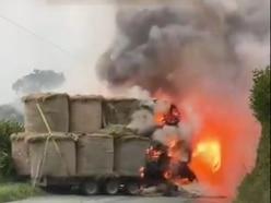 Fire crews battle tractor blaze on rural road