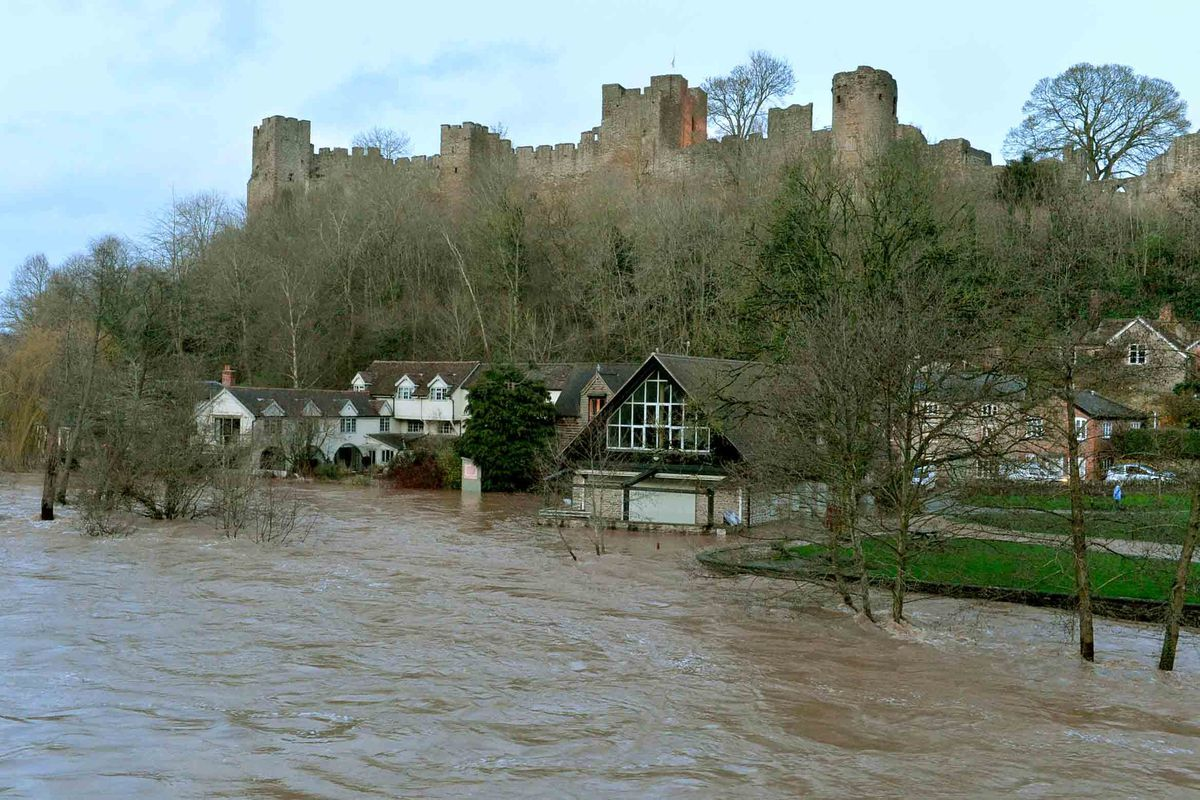 Ludlow Castle sits dry above the town's flooded roads
