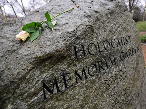 A rose is placed on the stone in the Holocaust Memorial Garden in Hyde Park, London