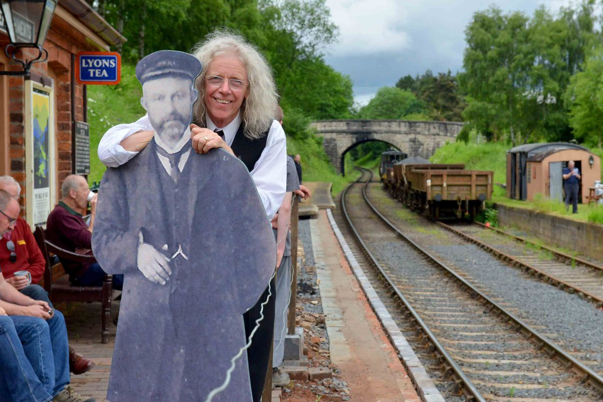 Station master Steve Downs with a friend from 1910