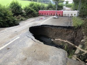 The sink hole on the B4355 at Lloyney, near Knighton, after last week's storms led to a culvert collapsing. Photo: Philip Grierson.