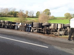 Driver taken to hospital after Wem road closed as lorry overturns