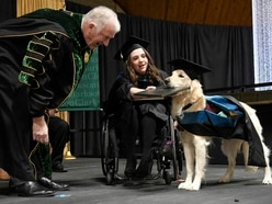 Top dog Griffin gets diploma after helping student through university course