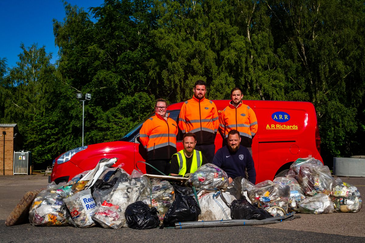 Some of the team with the masses of litter they collected. Back row from left are Chloe Richards, James Hallam and Alex Gammon, all of AR Richards. Front row are Matt Allen and Adam Rogers. Photo: Michael Wincott Photography