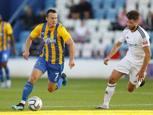 Shaun Whalley of Shrewsbury Town and Jason Oswell of AFC Telford United. (AMA)