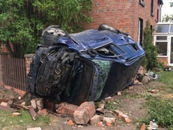 Woman and three children escape wreckage after car ploughs into wall