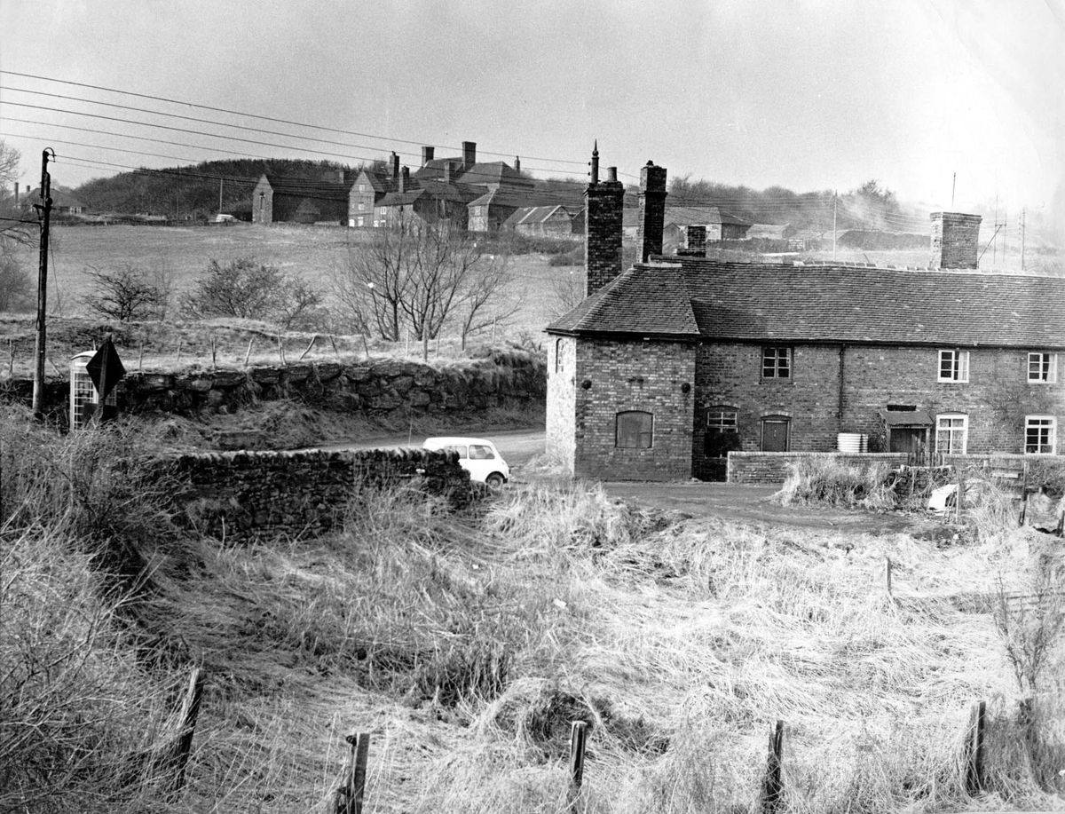 The view towards Top Farm (in the distance) in March 1969. Top Farm and the buildings in Dark Lane in the foreground were obliterated by the building of Telford town centre. The photo was taken from what is now the Hollinswood housing estate and Top Farm lies under the inner ring road of Telford town centre.