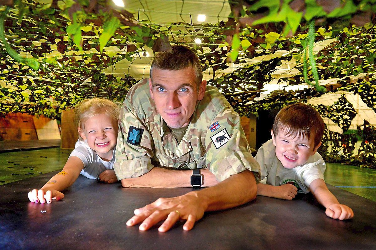 Colour Sergeant Lee Jones with Alannagh Chambers and Jaxon Potts, both aged four, at Buntingsdale Primary School