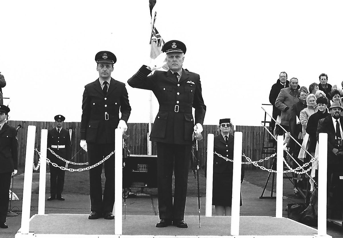 Taking the salute at a graduation parade.