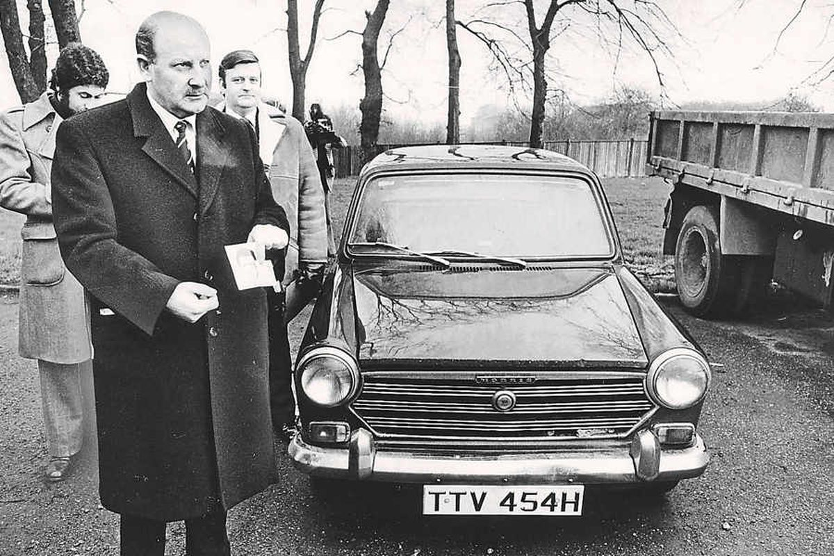 Detective Chief Superintendent Bob Booth by the Black Panther's stolen car