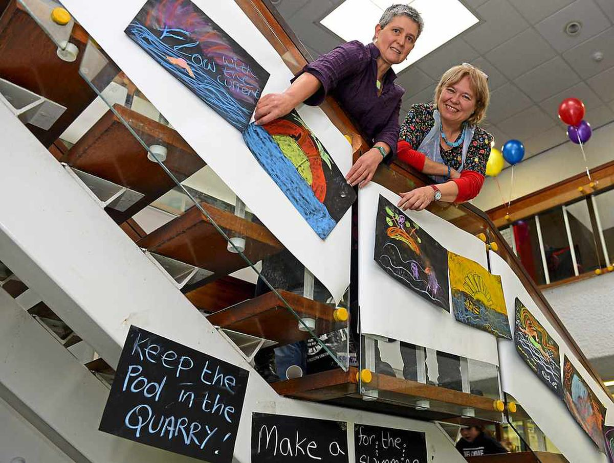 Ruth Gibson and Sue Challis hanging up the chalk pictures