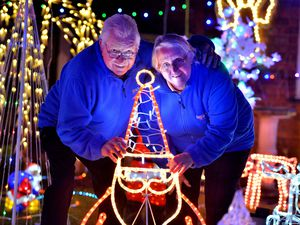 Brian and Tina Williams of Edgebolton, with their dazzling Christmas display raising money for Hope House hospices