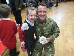 Kids welcome home hero military parents at Market Drayton school
