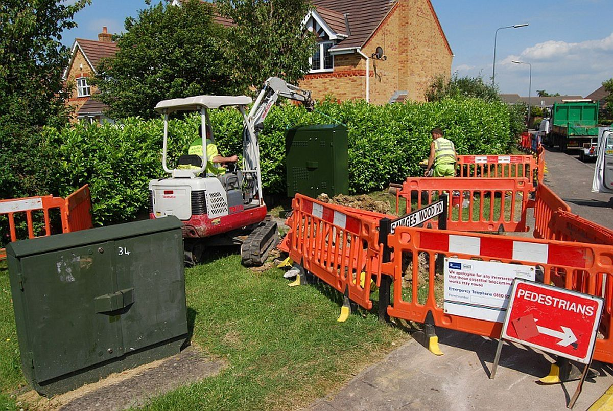 The casing for a new fibre-enabled broadband cabinet is lifted onto its base