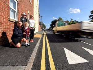 Parent governor Nicky Stewardson with her four-year-old daughter Lillie, Andy Boddington from Shropshire Council and Councillor Tracey Huffer