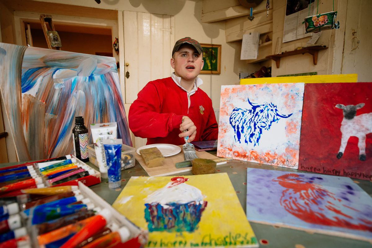 Charlie with his paintings