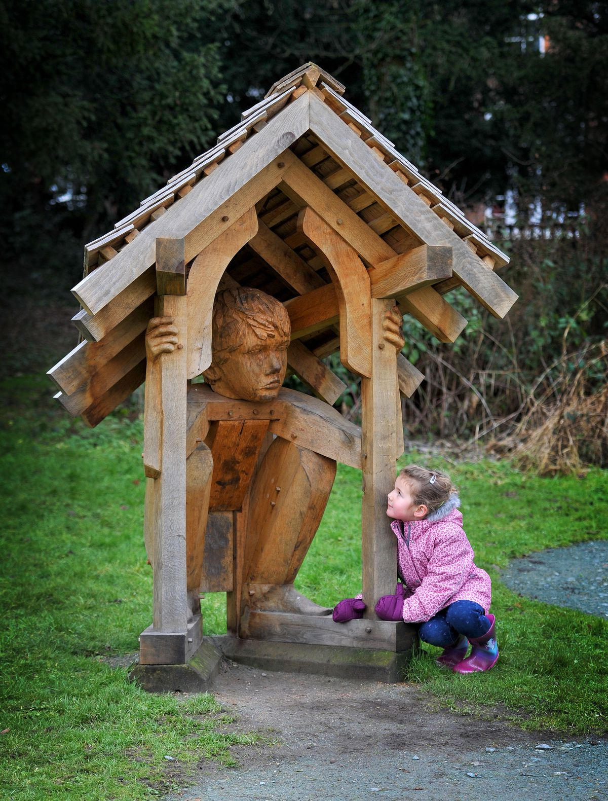 Casi Harrison, aged 4, looks at the statue at The Mere, Ellesmere