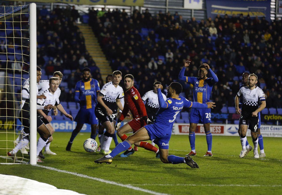 Scott Golbourne of Shrewsbury Town scores (AMA)