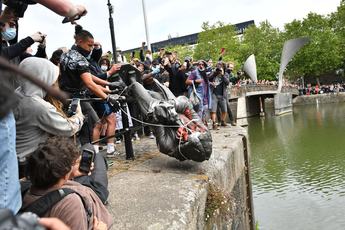 Protesters throw a statue of Edward Colston into Bristol harbour.