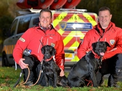 Poppy and Ted set tails wagging by joining river lifesavers