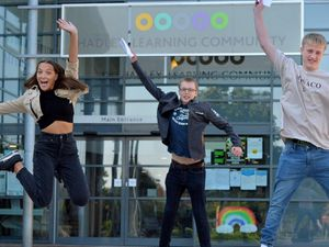 Grace Marshall, Oscar Humphreys and Ben Underwood, all 16, of Hadley Learning Community, in Telford, celebrate top grades