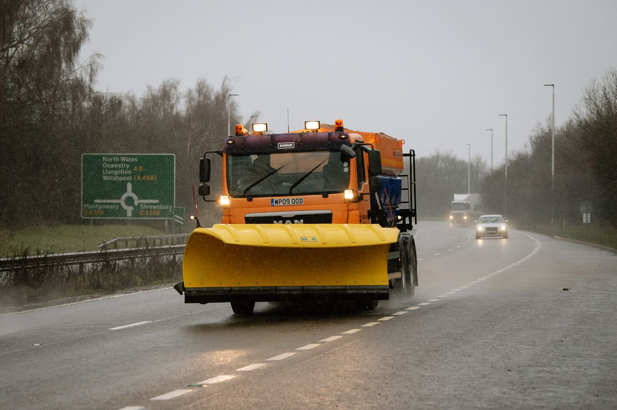 A snow plough heads out across Shrewsbury on Monday