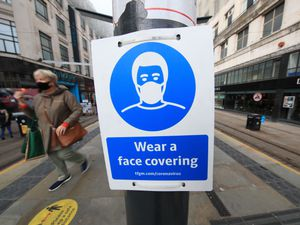 Face covering advice sign