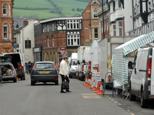 Shropshire Star copyright Andy Compton 29.4.14 Newtown Street Market feature words Andy Morris.  Broad Street, Newtown showing the vans used at the market. .