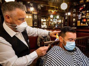 Barber cuts hair