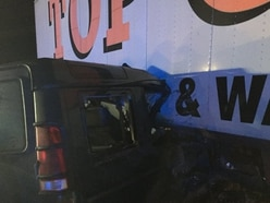 'Extraordinarily lucky escape' as Land Rover ends up wedged under lorry