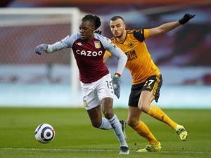 Bertrand Traore of Aston Villa is challenged by Romain Saiss of Wolverhampton Wanderers. (AMA)
